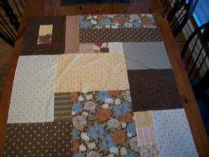 After sewing the pieces together, iron the seams flat.  This is easiest to do as you go along so that you are not having to work with a large quilt on your ironing board.